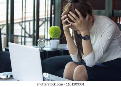 Business woman headache and stress from work,   noisy loud office giving a migraine, relieving stress, chronic pain,Failure to work.