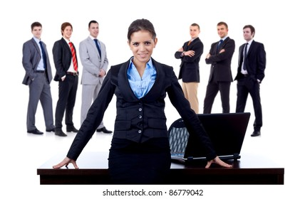 business woman at her desk and her team behind her, on white background
