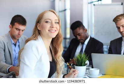 business woman with her staff, people group in background at modern bright office indoors.