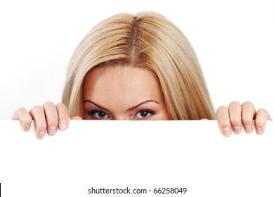 business woman hidden behind a white sheet of paper
