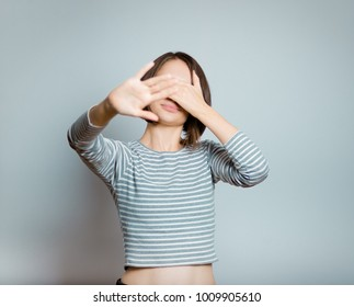 business woman hides her face from the camera, isolated on background, studio photo