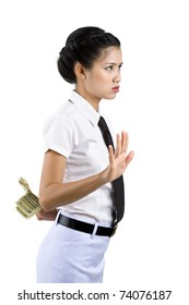 business woman hiding money behind her back, isolated on white background