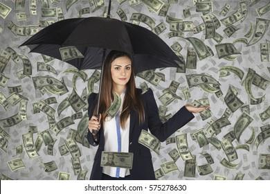 business woman hiding under an umbrella, falling money,