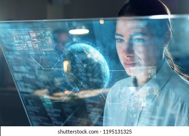 A business woman in his office reads financial news about the world economy on his futuristic newspaper in holography.