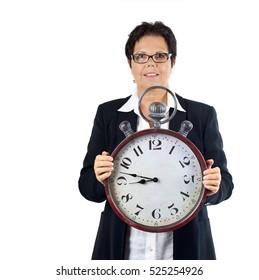 Business woman holding alarm clock