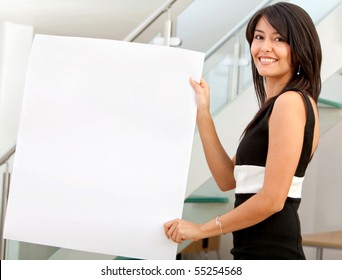 Business woman holding a banner at the office