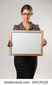 Business woman holding blank banner