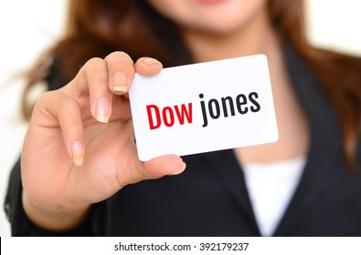 Business woman holding a card with the words dow jones