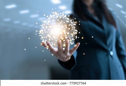 Business woman holding circle global network connection and data exchanges worldwide on work place background, business network communication and technology concept