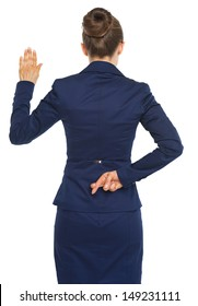 Business woman holding crossed fingers behind back while oath truth . rear view