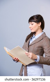 Business Woman Holding Documents in a modern office