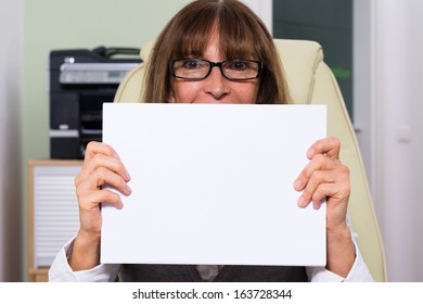 Business woman holding an empty peace of paper