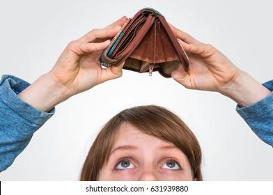 Business woman holding an empty wallet, she hasn't money