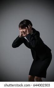 Business woman holding a head, failure