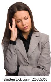 Business woman holding her head having a headache (close up)
