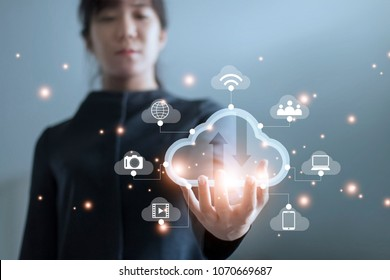 Business woman holding icon cloud computing network and icon connection data information in hand. Cloud computing and technology concept.