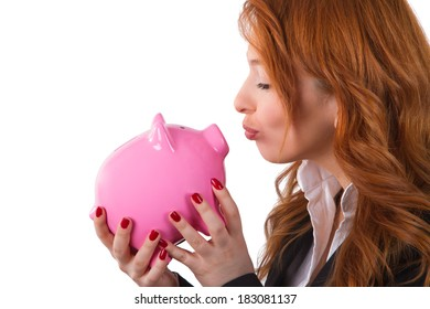 Business woman holding and kissing piggy bank, isolated on white background.