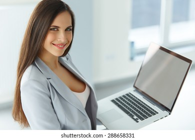 Business Woman Holding Laptop Computer
