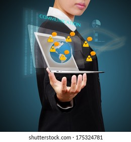 Business woman holding laptop show a social network on virtual screen. Concept of business communication.