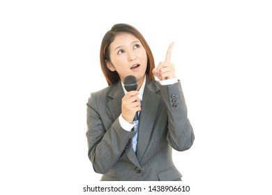 Business woman holding a microphone.