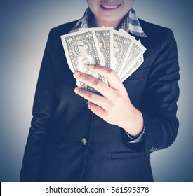 Business woman holding a money. Business concept.