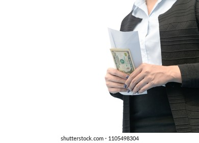 Business woman holding money under envelope isolated on white background - bribery, corruption and venality concepts