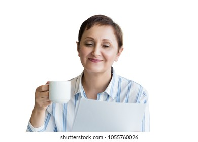 Business woman holding paperwork and drinking coffee. Professional headshot of middle aged older female reading contract/agreement/CV and smiling