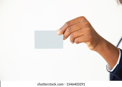 Business woman holding and showing credit or ID card. Closeup of blank plastic card in female hand. Presentation concept
