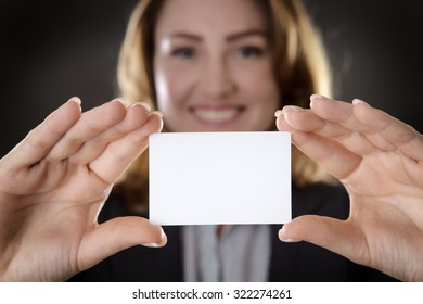 business woman holding up and showing you a blank white card