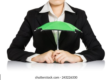 Business woman is holding small green umbrella isolated on white background, protect concept.