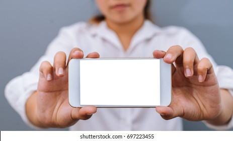 Business woman holding  smartphone in hands and show screen smartphone.vintage tone.