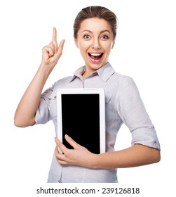 Business woman holding a tablet computer with finger up, isolated over a white background