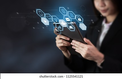 Business woman holding tablet and show sign technology icon. Future Technology Concepts.