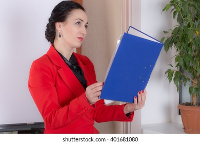 Business woman holding the thick blue folder. Photo can be used as a whole background.