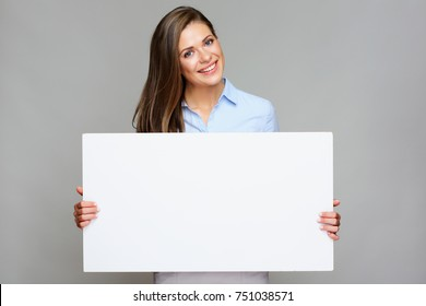 Business woman holding white big sign board. Isolated portrait.