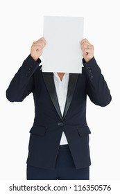 Business woman holding a white panel in front of her face in the white background