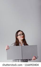 Business woman holding a wide open book