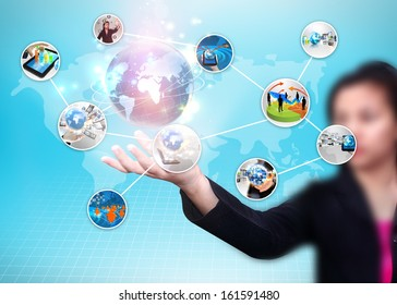 business woman holding business world
