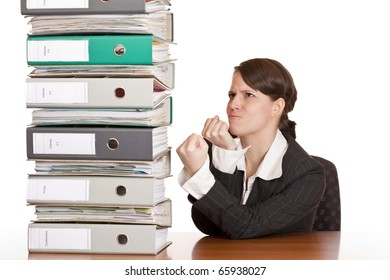 Business woman holds fists to file folder stack. Isolated on white background.