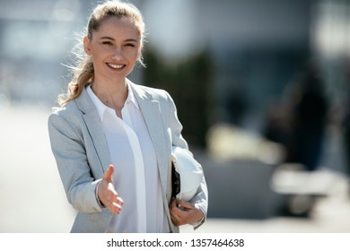 Business woman holds her hand for shake. Concluding a contract with a shake.