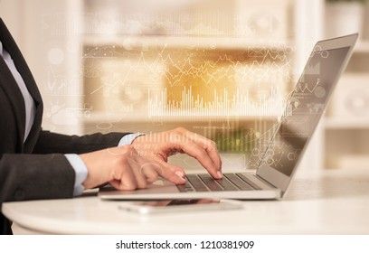 Business woman in homey environment using laptop with global financial report concept