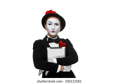 business woman in the image mime holding tablet PC and  easy looking at the camera. isolated on white background