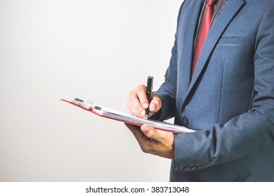 Business woman inspect a document