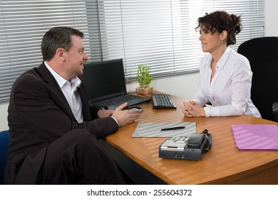 Business woman interviewing a  job applicant
