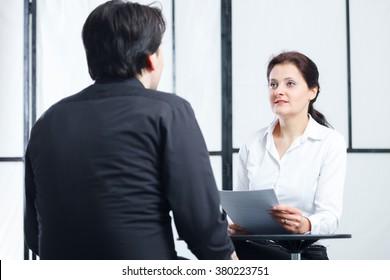 business woman interviewing a man for a job