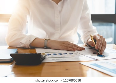 Business woman investment consultant analyzing company annual financial report balance sheet statement working with documents graphs. Concept picture of business, market, office, tax.