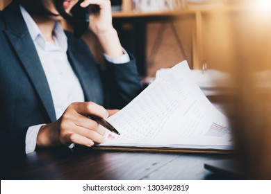 Business woman investment consultant analyzing company annual financial report balance sheet statement working with documents graphs. Concept picture of business, market, office, tax