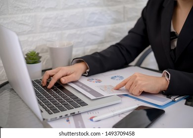 Business woman investment consultant analyzing company annual financial report balance statement working with documents graphics, Concept picture of economy,project, office,money and tax.