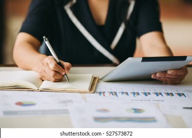 Business woman investment consultant analyzing company annual financial report balance sheet statement working with documents graphs. Concept picture of money, market, office,economy and tax.