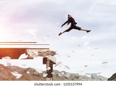 Business woman jumping over gap in bridge among flying paper planes as symbol of overcoming challenges. Skyscape with sunlight and nature view on background. 3D rendering.